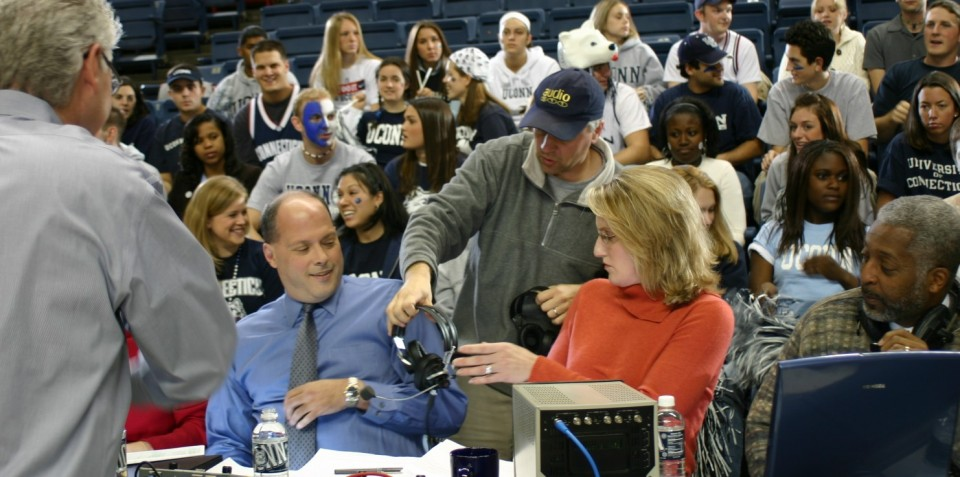 Distributing sportscaster headsets for a UCONN commercial
